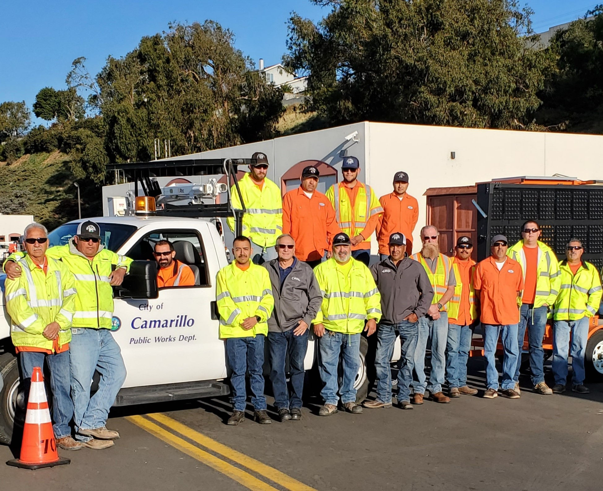 Public Works Employees Standing in front of City Truck
