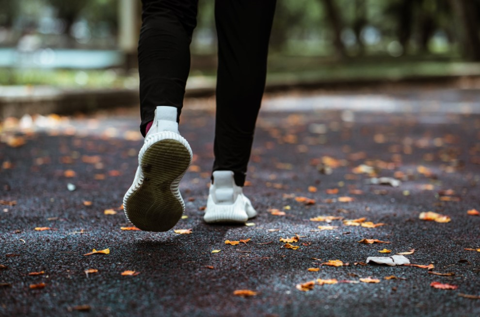 Person walking on a paved trail