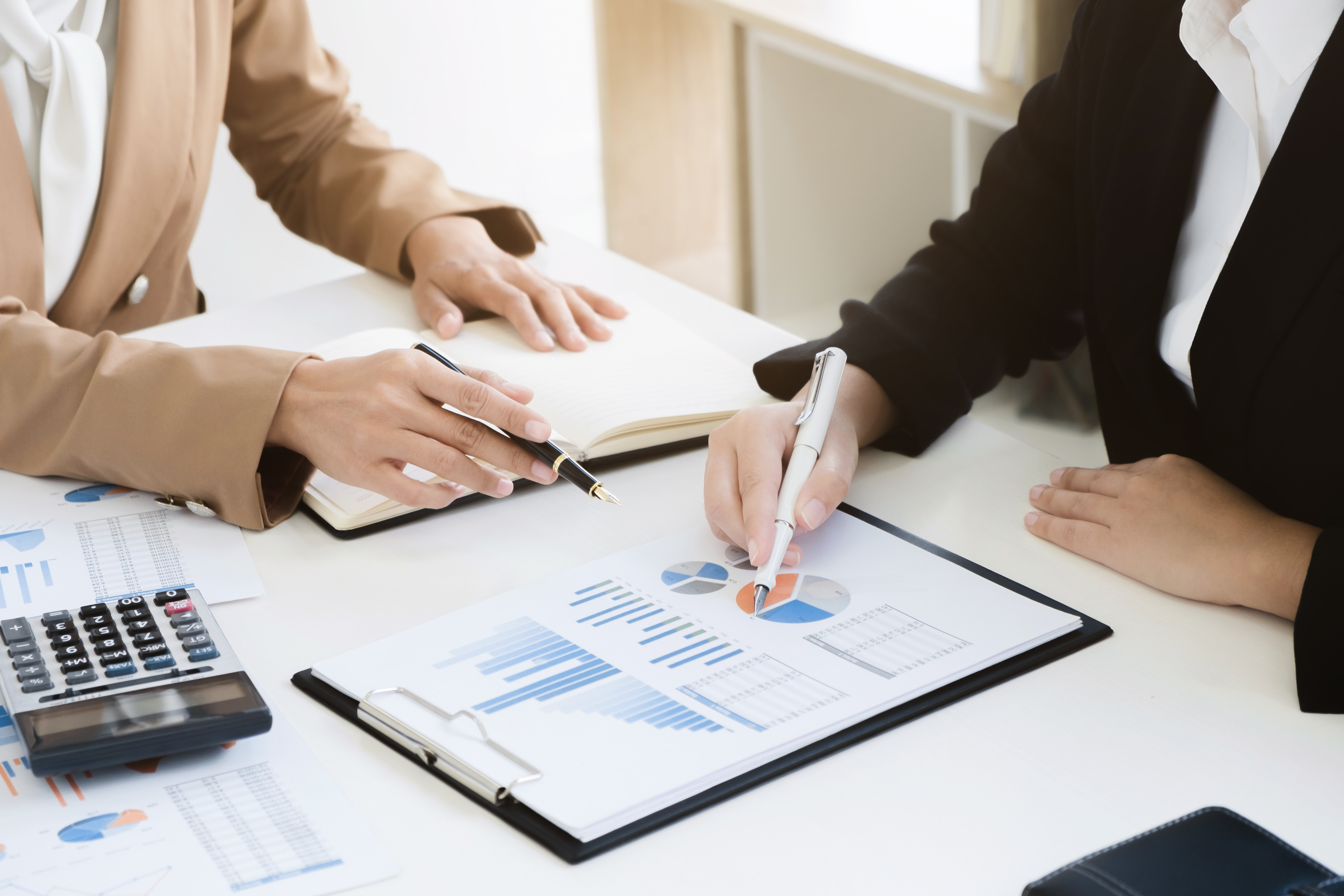 business financier audit working with calculator and data annual report