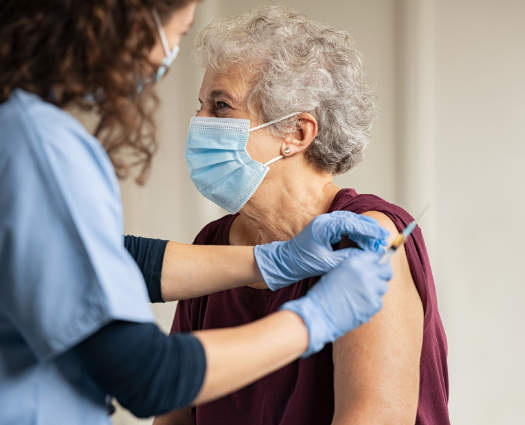 image of senior woman receiving vaccination