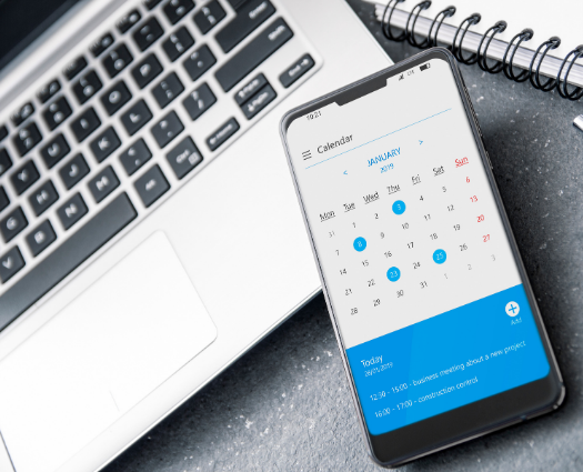 image of laptop and calendar on mobile phone screen