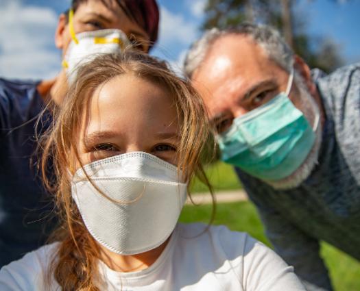 image of family wearing masks