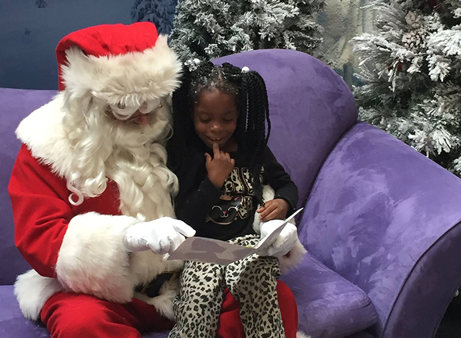 Signing Santa with little girl