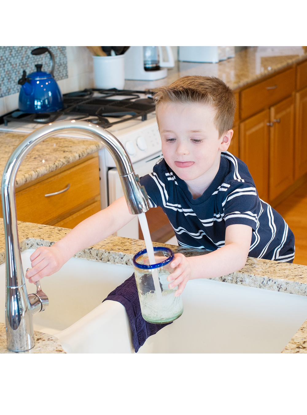 Young boy getting water