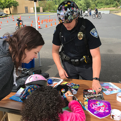 Neighborhood Police Helping child