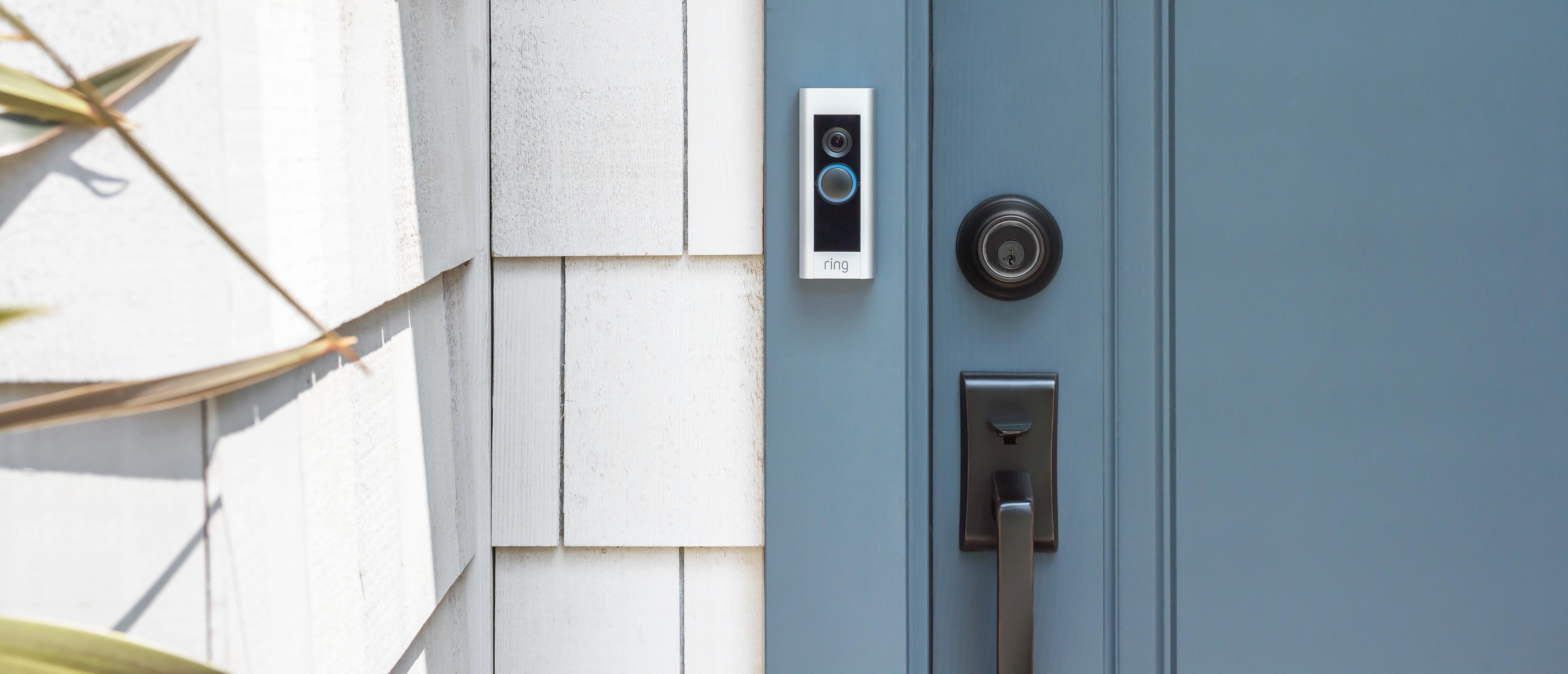 ring doorbell camera next to blue door
