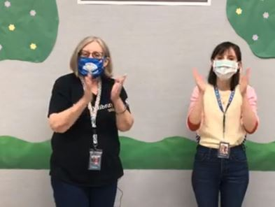 Library staff performing virtual storytime